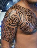 Samoan-Tribal-Tattoo-On-Half-Sleeve-And-Chest-For-Men